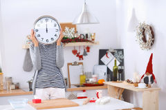 Happy young woman showing clock in christmas Stock Photos