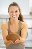 Happy young woman showing coconut Royalty Free Stock Image