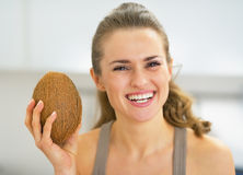 Happy young woman showing coconut Stock Photography