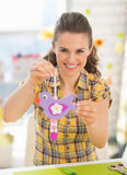 Happy young woman showing easter decoration Royalty Free Stock Photos