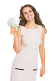 Happy young woman showing euros Stock Photos