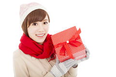 Happy  young woman showing  gift box Royalty Free Stock Photography