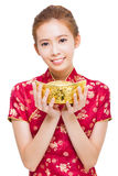 Happy young woman showing  gold for chinese new year Royalty Free Stock Images