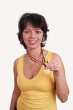 Happy young woman showing her gold medal Stock Photo