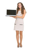 Happy young woman showing laptop Royalty Free Stock Image