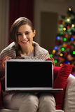 Happy young woman showing laptop blank screen Stock Photography