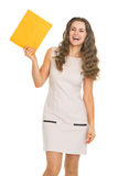 Happy young woman showing letter stock image
