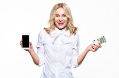 Happy young woman showing mobile phone blank screen and holding a five Euro banknote, smiling with excitement. Cheap phone bill, internet shopping royalty free stock photo