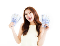 Happy young  woman showing the money Royalty Free Stock Photography