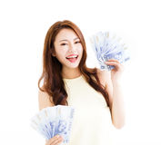 Happy young  woman showing the money Stock Photos