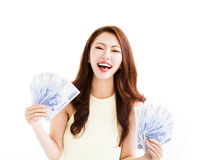 Happy young  woman showing the money Stock Image