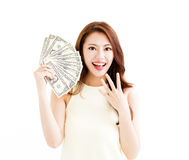 Happy young  woman showing the money Stock Images