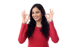 Happy young woman showing OK gesture Stock Image