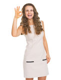Happy young woman showing ok gesture Royalty Free Stock Photos