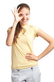 Happy young woman showing ok sign Stock Image