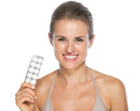 Happy young woman showing pills Royalty Free Stock Photography