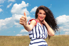 Happy young woman showing the thumbs up gesture Royalty Free Stock Image