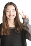 Happy young woman showing victory gesture Royalty Free Stock Image