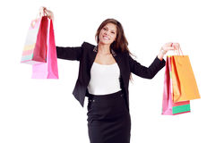 Happy young woman shows bags with purchases Royalty Free Stock Images