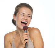 Happy young woman singing in brush Stock Image