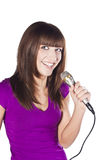 Happy young woman singing with microphone Royalty Free Stock Photos