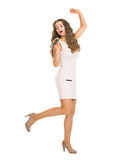 Happy young woman singing in microphone Royalty Free Stock Photography