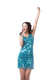 Happy young woman singing in short sparkling blue dress. Slender young female talent in short sparkling blue dress, having fun, singing karaoke with emotions royalty free stock photography