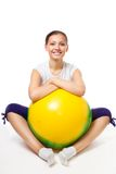 Happy young woman sit with fitness ball Royalty Free Stock Images