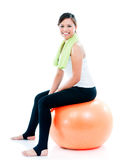 Happy Young Woman Sitting On Balance Ball Stock Images