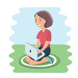 Happy young  woman sitting on cushion with laptop in lap Royalty Free Stock Photography