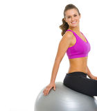 Happy young woman sitting on fitness ball Royalty Free Stock Photos