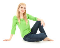 Happy young woman sitting on the floor Royalty Free Stock Images