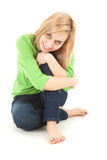 Happy young woman sitting on the floor Stock Photos