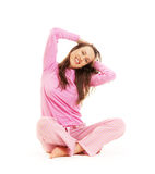 Happy young woman sitting on the floor Royalty Free Stock Image
