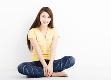 Happy young woman sitting on the floor Royalty Free Stock Photography