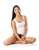 Happy young woman sitting on the floor Royalty Free Stock Photos