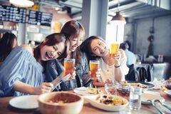 Free Happy Young Woman Sitting In  Restaurant And Enjoy Dinner And Beer Stock Images - 177538524