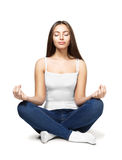 Happy young woman sitting in lotus position Royalty Free Stock Photos