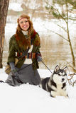 Happy young woman sitting with siberian husky dog Royalty Free Stock Images