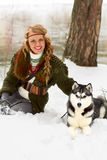 Happy young woman sitting with siberian husky dog Stock Images