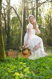 Happy young woman sitting on a swing outdors. Portrait of a happy young woman sitting on a swing outdoors Royalty Free Stock Photography