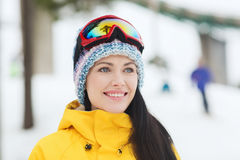 Happy young woman in ski goggles outdoors Royalty Free Stock Photos