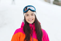 Happy young woman in ski goggles outdoors Stock Photo
