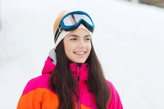 Happy young woman in ski goggles outdoors Royalty Free Stock Photography