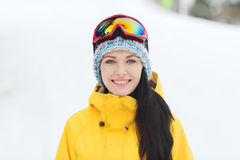 Happy young woman in ski goggles outdoors Stock Images