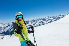 Happy young woman skier enjoying sunny weather in Alps Stock Images