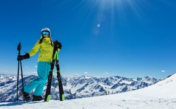 Happy young woman skier enjoying sunny weather in Alps Stock Photo