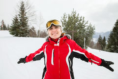 Happy young woman in skiing jacket Stock Image