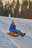 Happy Young Woman Sleigh Ride. Happy Young Woman on a fast Sleigh Ride down the icy slope Royalty Free Stock Images