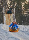 Happy Young Woman Sleigh Ride. Happy Young Woman on a fast Sleigh Ride down the icy slope Royalty Free Stock Photography